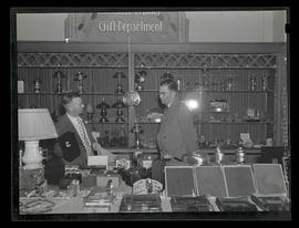 Two men in gift department at Blumauer-Frank Drug Company, Portland