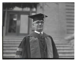 Unidentified man wearing academic regalia, half-length portrait