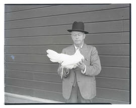 Man holding chicken