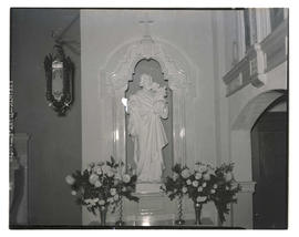 Statue of Joseph and Jesus in church nave