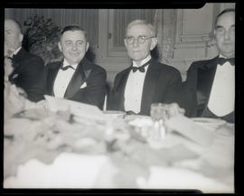Joseph K. Carson, unidentified man, and Julius L. Meier at formal event