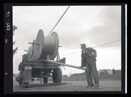Utility line worker with rolls of cable