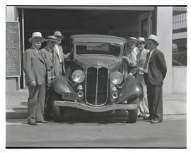 Six men with car