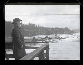Unidentified man on balcony overlooking Willamette Falls