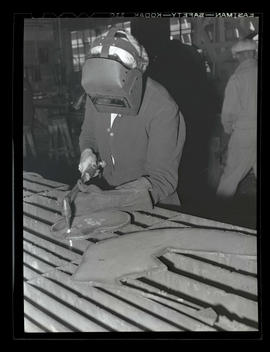 Welder Jeannine Christensen using blowtorch, Albina Engine & Machine Works, Portland