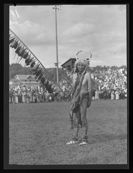 Indigenous American with feather staff at the Pendleton Round-Up