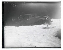 Car driving through snow in forest