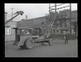 Worker with truck-mounted crane during swing shift, Albina Engine & Machine Works, Portland