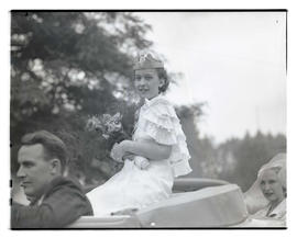 Festival queen? sitting in open-topped car