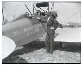 Three men with Rankin School of Flying airplane