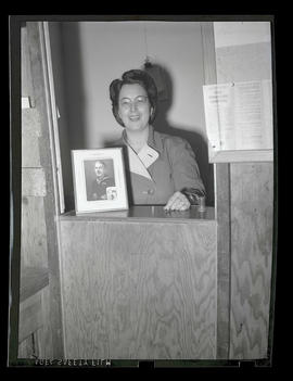 Employee standing in booth, Albina Engine & Machine Works, Portland