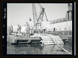 Cable crossing barge and tug boat