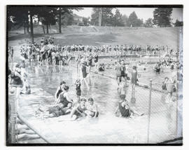 Crowd at outdoor swimming pool