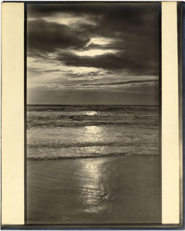 Surf and clouds, unidentified beach