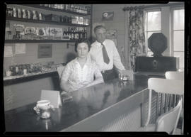 Mr. and Mrs. R. W. LaDue, operators of Robinwood service station, after holdup