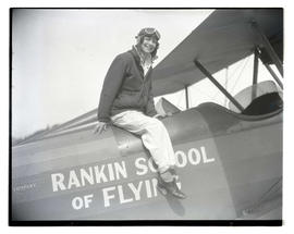 Ann Bohrer, student at Rankin School of Flying, sitting on airplane