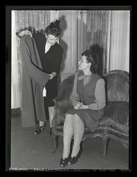 Unidentified woman showing coat to Jeannine Christensen, welder at Albina Engine & Machine Works