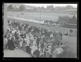 Crowd watching horse race at Gresham track