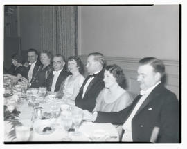Willem van Hoogstraten and unidentified diners at event