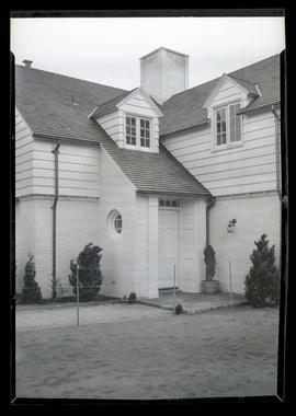 Front door of unidentified-two story house