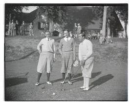 Mel Smith, Frank Dolp, and unidentified man on golf course