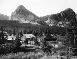 Cut Bank River chalets with fisherman, Glacier Park, Montana, 1912