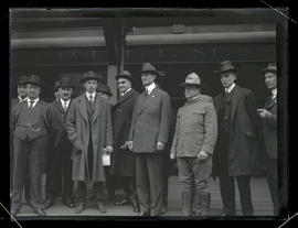 William Gibbs McAdoo with group of unidentified men on train platform