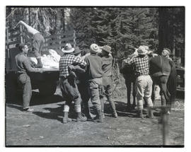 Searchers lifting body of climber into truck at Olallie Lake, Oregon