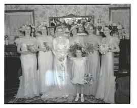 Unidentified bride with bridesmaids and flower girl