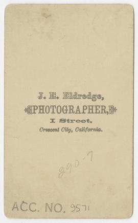 Portrait of an unidentified young boy from J. E. Eldredge Studio (verso)