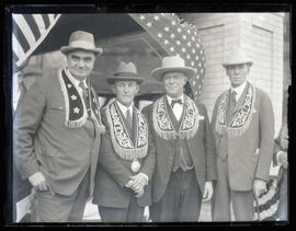 George L. Baker, Walter M. Pierce, and two unidentified men