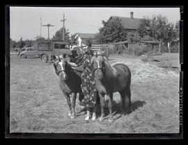 Woman with two ponies
