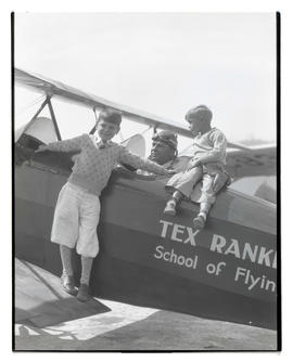 Tex Rankin and two boys with airplane