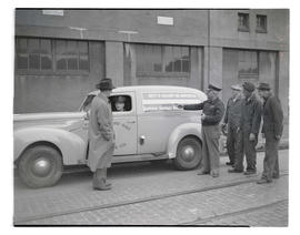 Unidentified men with Portland Gas & Coke car advertising defense bonds