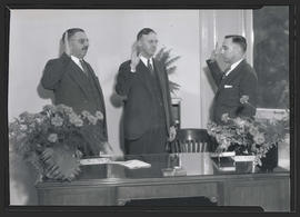 Three unidentified men at oath ceremony