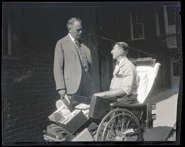 George, speaking with unidentified man