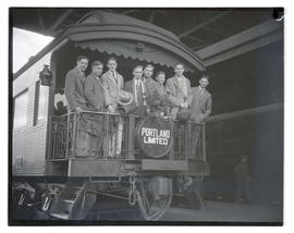 Young men on Portland Limited train car