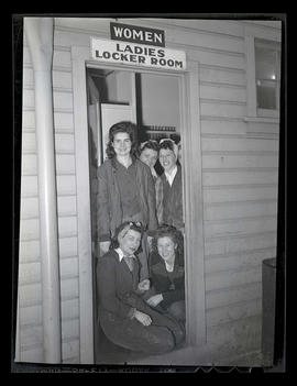 Swing shift workers in doorway of women's locker room, Albina Engine & Machine Works, Portland