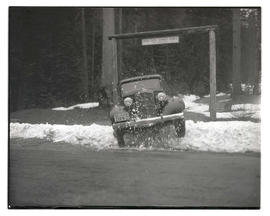 Car driving through snow at entrance to Union Creek Summer Homes