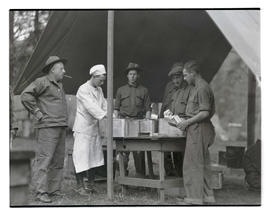 Civilian Conservation Corps workers preparing food at Toll Gate camp?