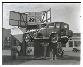 Car on lift at Fred Meyer Hollywood Market Oil Station, Portland?