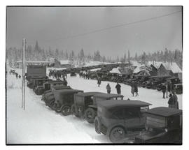 Cars parked along snow-covered road in Government Camp, Oregon