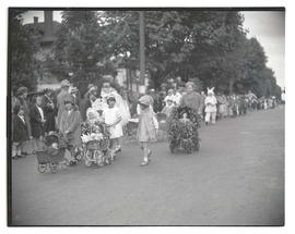 Children pushing doll carriages in parade