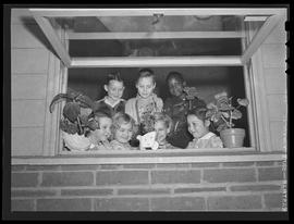 Vanport school children with potted plants given to them by Portland youngsters