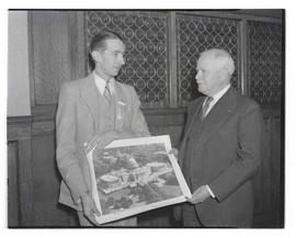 Steuer and Charles H. Martin holding photograph of United States Capitol
