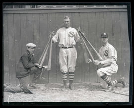 Baseball player holding six bats