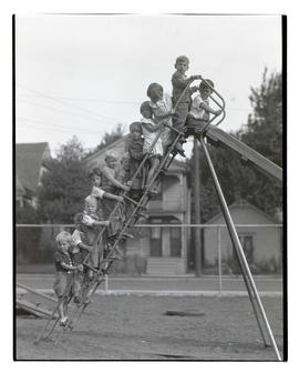 Group of children on ladder of playground slide