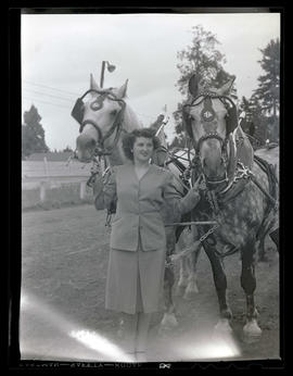 Woman with two harnessed horses
