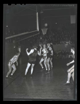 Basketball game between Albina Hellships and unidentified team