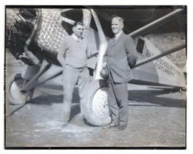 "Tex Rankin and unidentified man with airplane, ""Queen of the Cascades"""